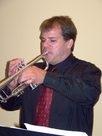Photo of Jeff Loughlin playing the trumpet